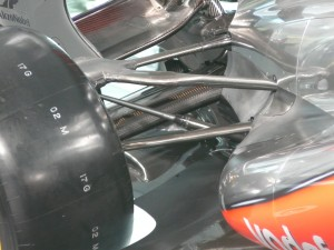 Mclaren's 2013 Raise wishbone set up, note the upper wishbone mount being inboard and above of the wheel rim